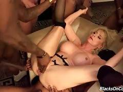 Nasty white cougar has fun with a crowd of black studs.